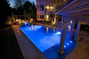 Photo Of The Backyard Pool Lit Up At Night, An Example Of The Kind Of Accommodation The Patrons Caddy Offers During The Masters.